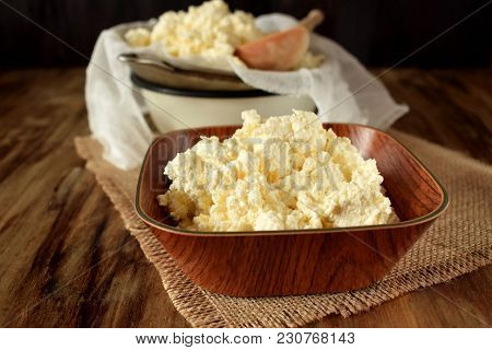 Cottage Cheese In A Wooden Bowl On Sackcloth