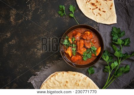Hot Spicy Chicken Tikka Masala In Bowl.a Popular Indian Spicy Dish. Top View, Close-up