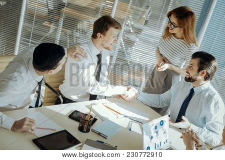 Conflict Solved. Pleasant Male Office Workers Shaking Hands, Having Reconciled With Each Other With