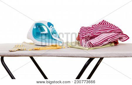 Functional Electric Iron And Clean Clothes On Ironing Board, Isolated On White Background