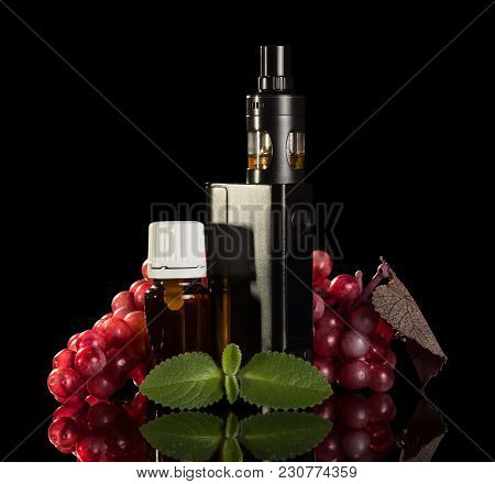 Electronic Cigarette, Liquid For Smoking, Bunch Of Grapes And Mint Leaf Isolated On Black Background