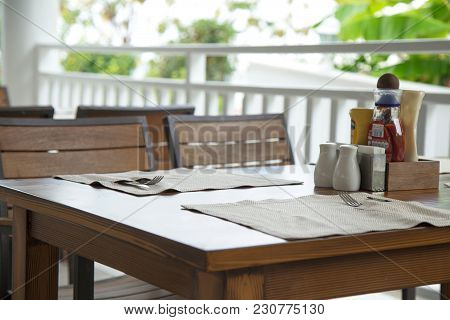 Table Served. Wooden Table Served. Outdoor Restaurant