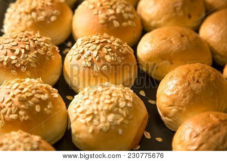 Fresh Buns Background. Appetizing  Buns With Sesame Seeds. Freshly Baked Wheat Buns With Sesame Seed