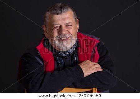 Nice Low Key Portrait Of Bearded Smiling Senior Man