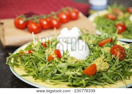 Italian Burrata And Mozzarella With Cherry Tomatoes And Pesto Sauce