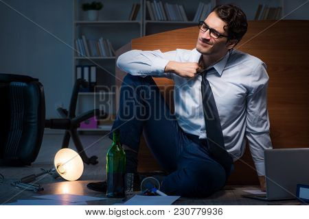 Stressed businessman working overtime in depression