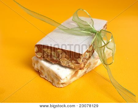 Nougat in two flavors with a ribbon on a yellow background