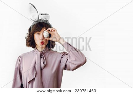 Beautiful Stylish Girl In Bunny Ears Holding Easter Egg With Funny Emotions On White Background Isol