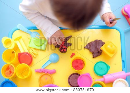 Top View Of Little Asian 18 Months Old Toddler Baby Boy Child Having Fun Playing Colorful Modeling C