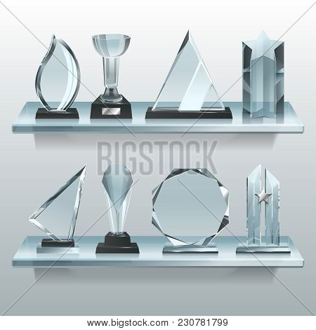 Collections Of Transparent Trophies, Awards And Winner Cups On Shelf Of Glass. Trophy And Award Priz