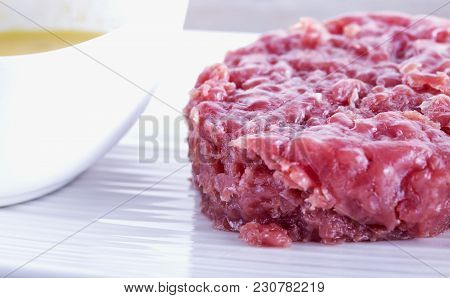 Raw Meat Over White Plate