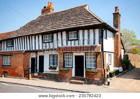 Traditional English Tudor style timber frame cottage with slate roof in Southern  England, UK