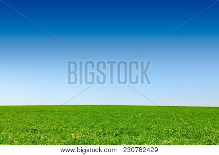 Idyllic english rural landscape with scenic green field under a blue summer sky in Southern England UK
