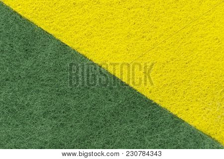 Background Of Two Colored Green And Yellow Non-woven Fibrous Abrasive Material, Divided Diagonally