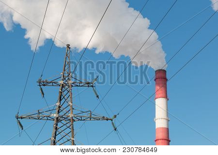 Industrial, Ecology And Environmental Protection. High Voltage Power Line Support And Smoke From The