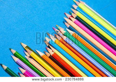color pencils on blue background