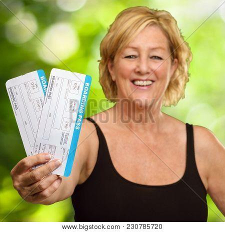 Happy Elderly Woman Holding Boarding Pass, Outdoor