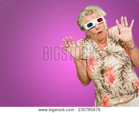 Afraid Senior Woman Watching 3d Movie On Pink Background