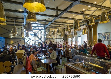 Paris, France, March 28 2017: Giant clock of Musee dOrsay with unidentified people. It houses in the former Gare d'Orsay, a Beaux-Arts railway station. It is one of the largest museums in Europe