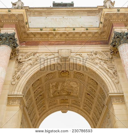 Paris, France - March 28, 2017: The Carrousel Triumphal Arch Arc de Triomphe du Carrousel in front of the Louvre