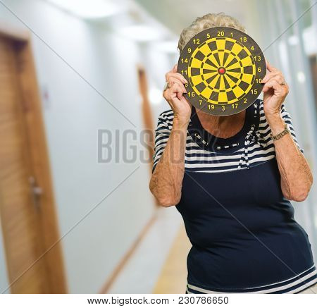 Woman Hiding Her Face With Dart Board, Indoor
