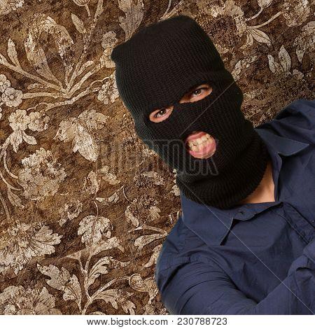 Burglar Man Shouting against wallpaper
