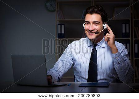 Call center operator talking to customer during night shift