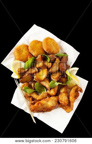 Different Fries, Isolated On Black. Fried Chickpea Patties, Potato Wedges And Slices Of Chicken Brea