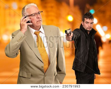 Gangster Shooting Business Man Using Phone, Outdoor