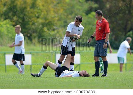 KAPOSVAR, HUNGARY - AUGUST 27: Unidentified player injured at the Hungarian National Championship under 18 game between Kaposvar (green) and Gyor (white) August 27, 2011 in Kaposvar, Hungary.