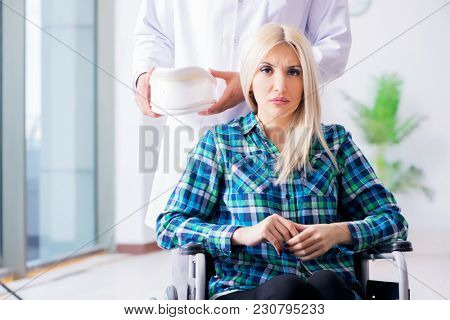 Disabled woman in wheel chair visiting man doctor