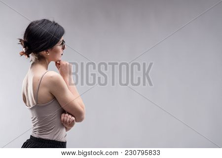 Young Brunette Woman Looking At Copy Space