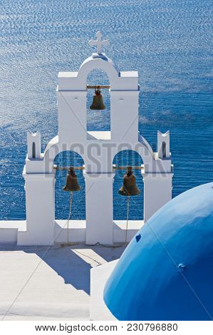 The Three bells of Fira and blue dome, Santorini, Greece, Europe.
