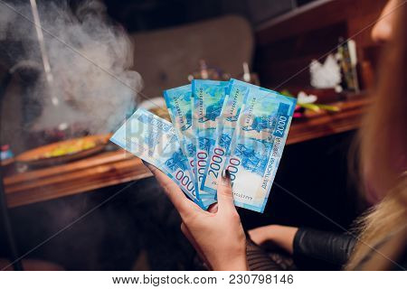 New Russian Banknotes Denominated In 2000 Rubles In Female Hands Close-up On A Club Background Girl