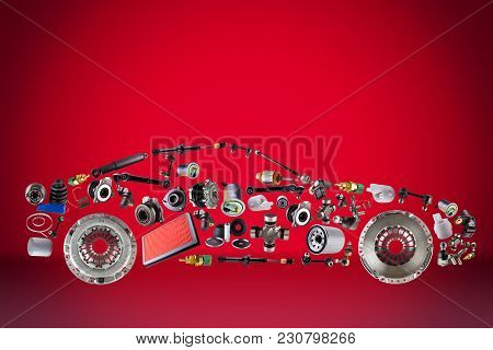 Passenger Car Assembled From New Spare Auto Parts For Shop Aftermarket. Isolated On Red Background.