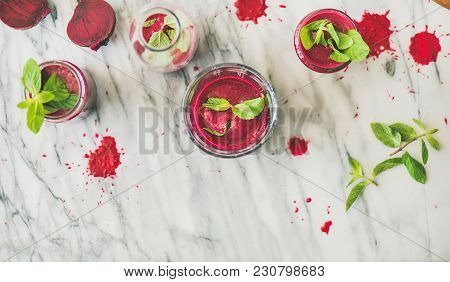 Fresh Morning Beetroot Smoothie Or Juice In Glasses With Mint Leaves Over Grey Marble Background, Co
