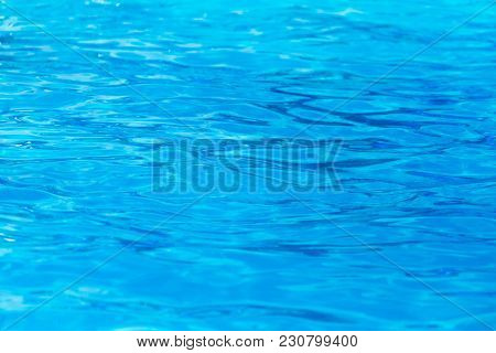 Expanse Of Blue Water In The Pool As A Background .