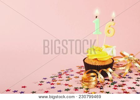 16th Birthday Cupcake With Candles, Sprinkles And Ribbon On Pink Background. Card Mockup, Copy Space