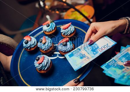 Girl Holds 5 Bills Of New 2000 Rubles Cash And Pays For Cakes In The Club Restaurant