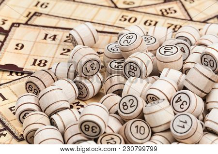 Bunch Of Wooden Barrels With Numbers On The Bingo Game Cards