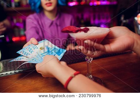 Girl Holds 5 New 2000 Rubles Cash And Pays For A Cocktail Bartender At The Club Restaurant