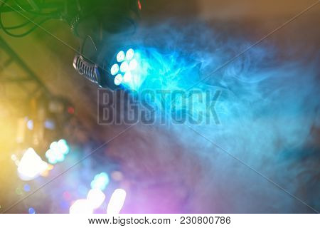 Color Led Spotlight Shines Through Dispersing Smoke, Entertainment Equipment, Light Music At Dance P