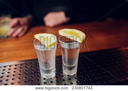 Tequila Shot With Lime And Sea Salt On Black Table, Selective Focus Club