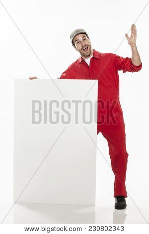 Full Length Portrait Of A  Technician In A Uniform Doing Positive Gestures On A White Panel