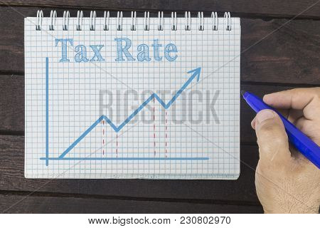 Business, Finance, Investment, Saving And Cash Concept - Business Man Drawing Graph Of Tax Rate.