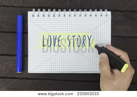 Human Hand Writing On Notepad: Love Story.