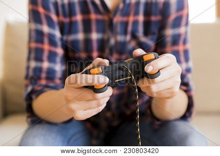 Young Girl Holding Joystick While Playing Video Games