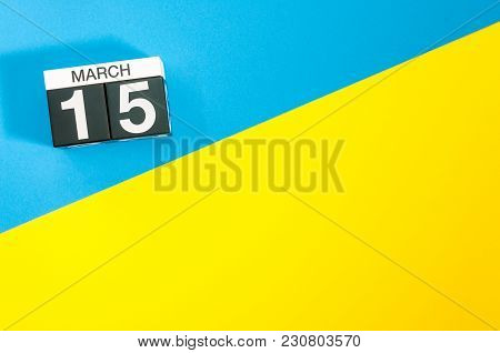 March 15th. Day 15 Of March Month, Calendar On Blue And Yellow Background Flat Lay, Top View. Spring