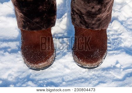 Brown Winter Boots For Women With A Natural Fur On The Snow
