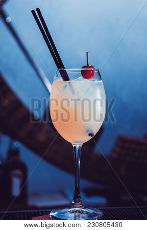 alcohol drink with cherry on bar. cocktail